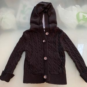 Black cable knit sweater with hood and buttons